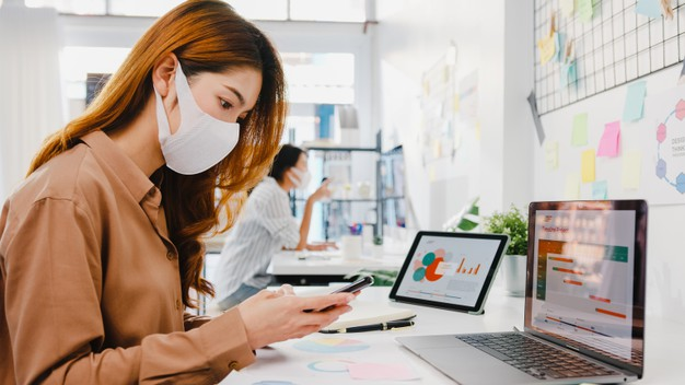 asia-businesswoman-entrepreneur-wearing-face-mask-social-distancing-new-normal-situation-virus-prevention-while-using-laptop-phone-back-work-office_7861-3184