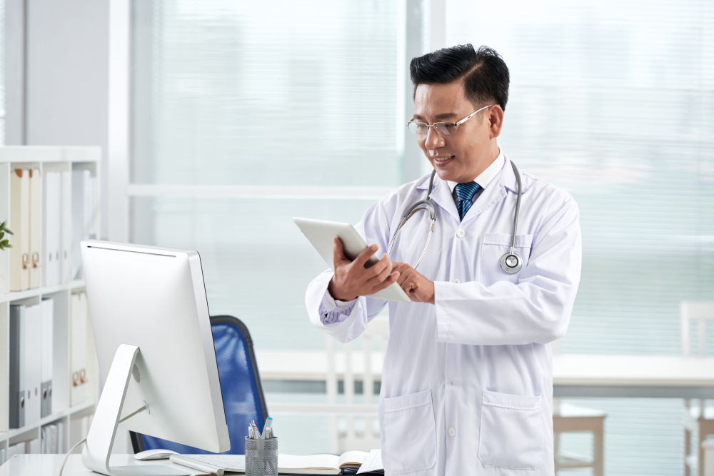 asian-doctor-using-medical-app-his-digital-device
