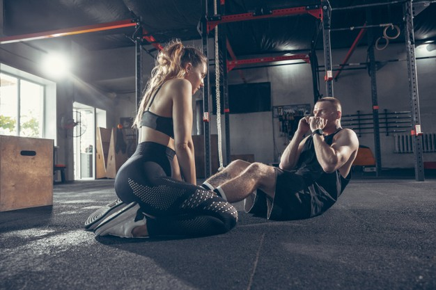 beautiful-young-sporty-couple-workout-gym-together_155003-38502