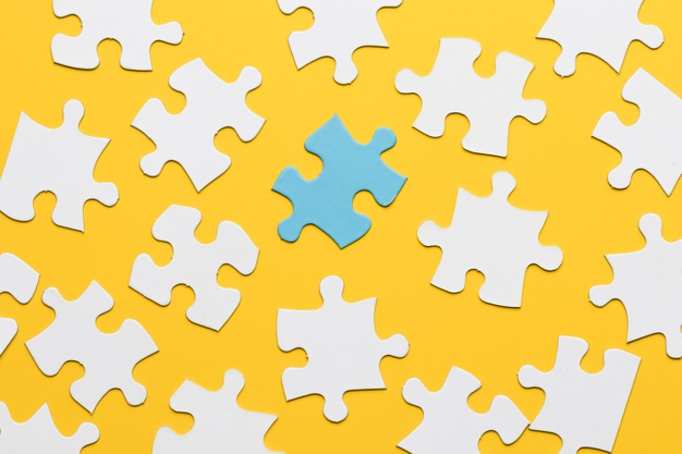 blue-puzzle-with-white-jigsaw-piece-yellow-background_23-2148207373
