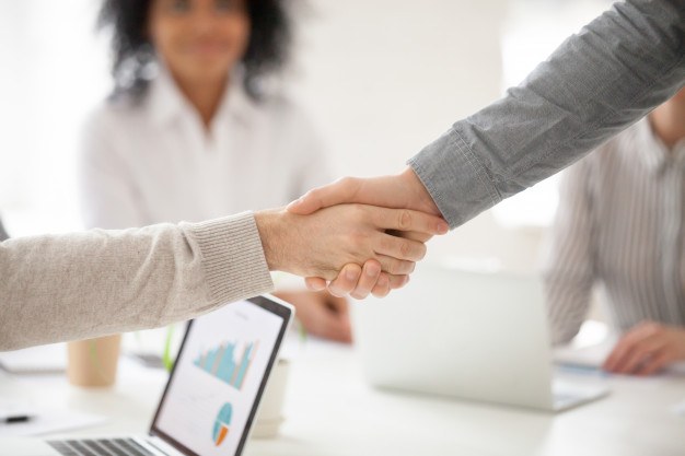 business-partners-handshaking-group-meeting-making-project-investment-closeup_1163-5108