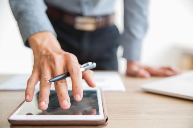 businessman-using-digital-tablet-office_1262-2239