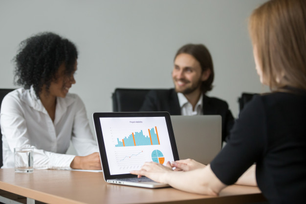 businesswoman-working-with-project-statistics-preparing-report-team-meeting_1163-3899