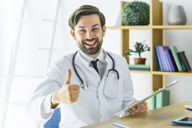 cheerful-doctor-gesturing-thumb-up_23-2147896156