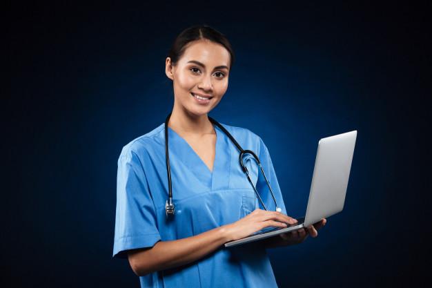 cheerful-lady-medical-uniform-using-laptop_171337-4286