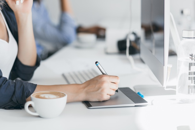 close-up-photo-female-hand-holding-stylus-tablet-indoor-portrait-freelance-web-developer-working-project-during-coffee-break-office_197531-3745