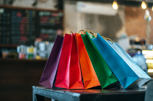 colorful-paper-bags-placed-table_1150-18774