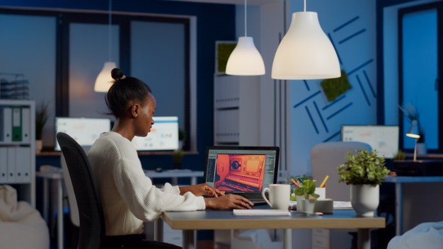 dark-skin-gamer-developer-working-video-game-midnight-from-business-office-using-professional-laptop_482257-2428