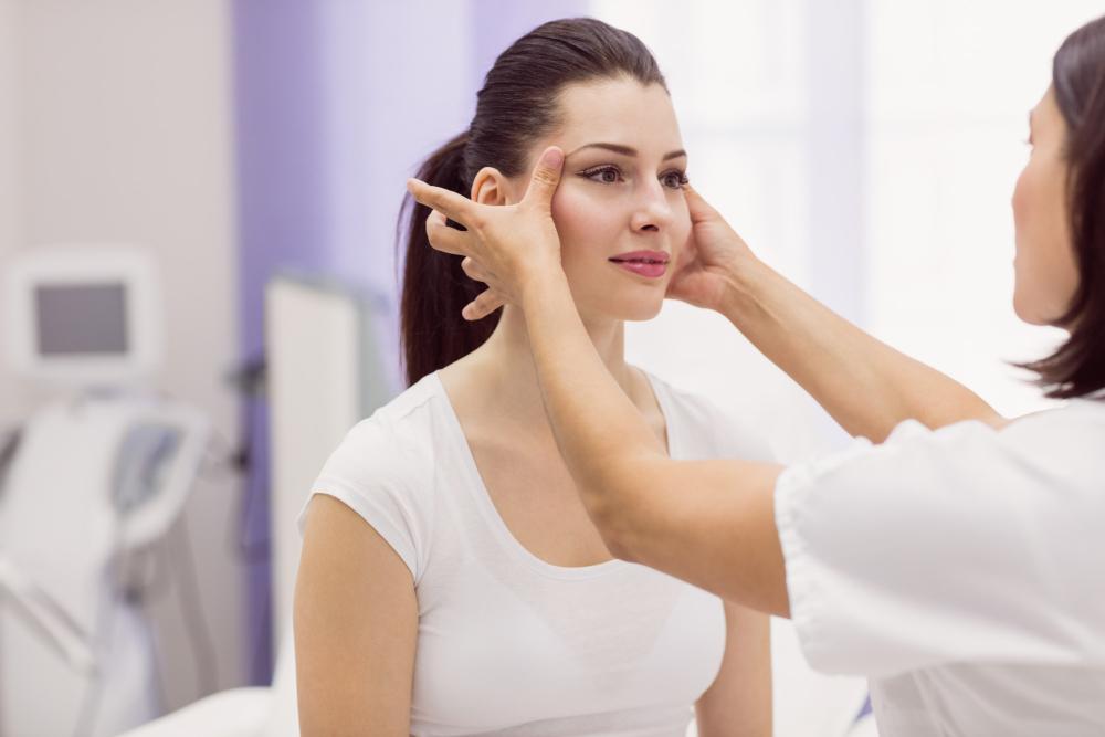 dermatologist-examining-female-patient-skin