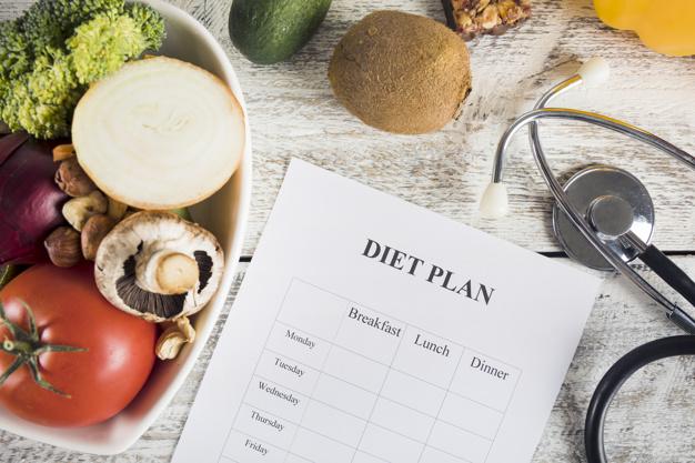 diet-plan-with-vegetables-stethoscope-wooden-desk_23-2147882126