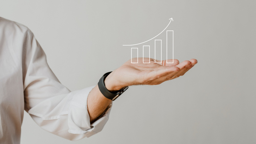 digital-increasing-bar-graph-with-businessman-hand-overlay