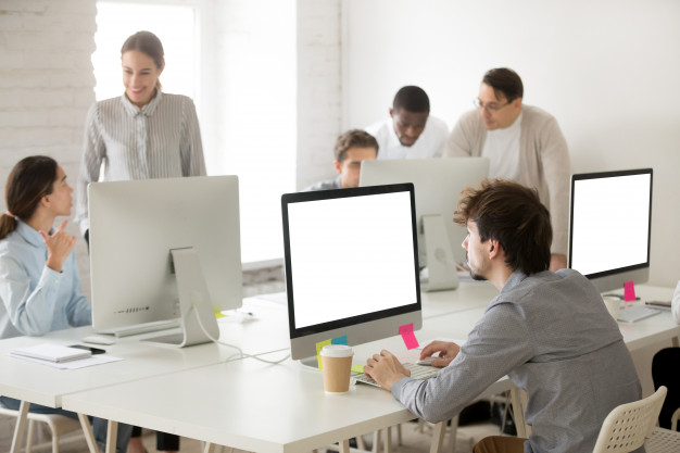 diverse-corporate-employees-group-working-together-using-computers-office_1163-5124