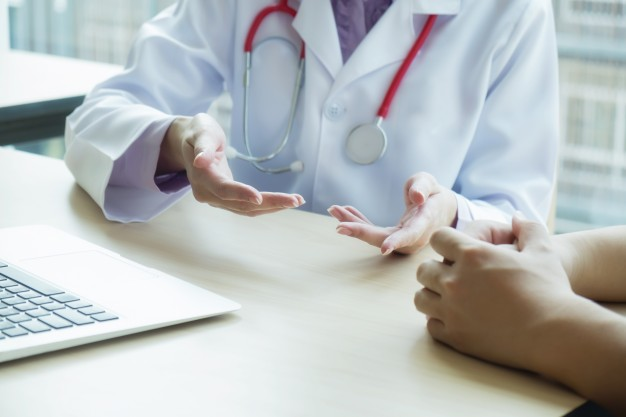 doctor-patient-are-discussing-something-just-hands-table_1421-51