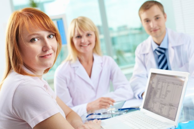 doctors-looking-through-medical-record_1098-2328