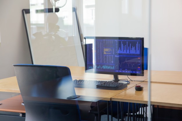 empty-traders-workplace-glass-wall-office-room-with-flipchart-desk-with-chair-computer-trading-charts-monitor-stock-market-exchange-concept_74855-14234