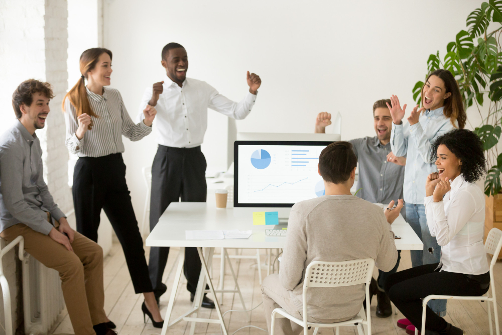 excited-by-good-news-motivated-colleagues-celebrating-corporate-success-together