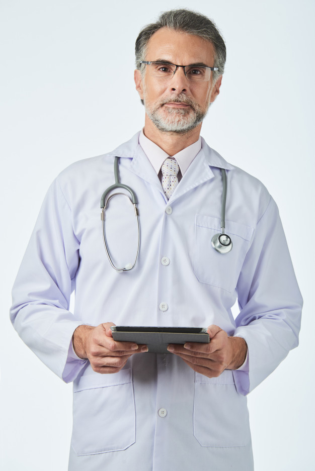 general-practitioner-with-stethoscope-shoulders-holding-digital-tab-looking-camera_1098-19297