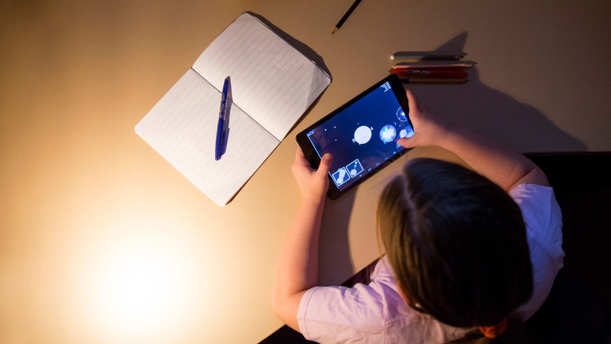 girl-playing-tablet-game-evening (1) (1)