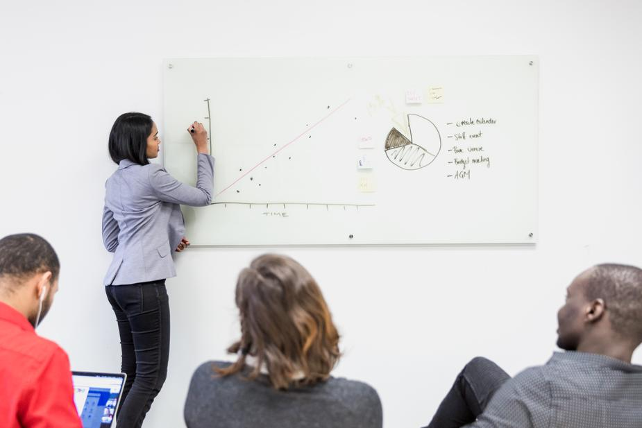 girl-presents-on-whiteboard