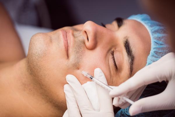 man-receiving-botox-injection-his-face