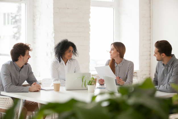 multiracial-male-female-colleagues-having-discussion-team-meeting_1163-5107