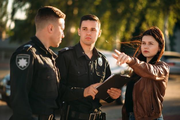 policeman-write-testimony-female-driver_266732-11001