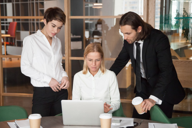 serious-focused-business-team-discussing-online-task-together-office_1163-4773