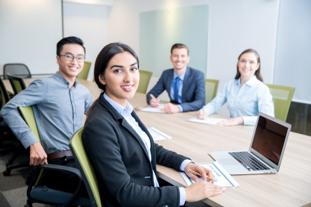 smiling-business-lady-working-with-colleagues_1262-2153