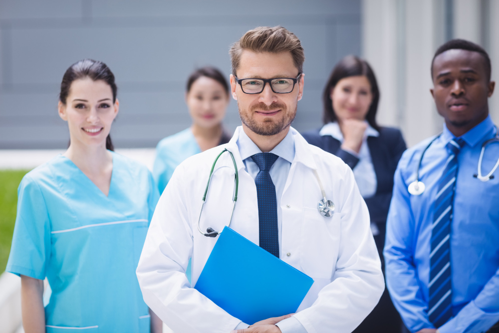 team-doctors-standing-together-hospital-premises