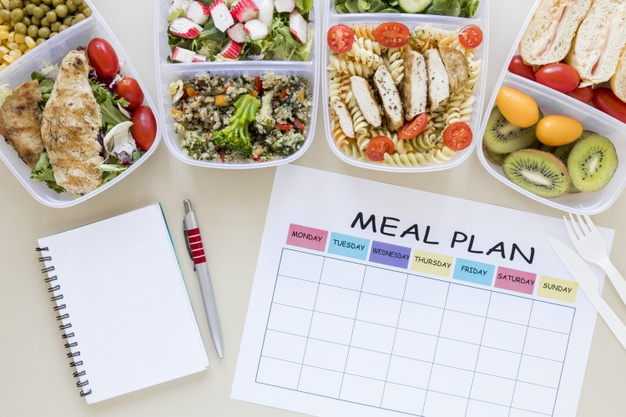top-view-assortment-food-with-planner_23-2148484699