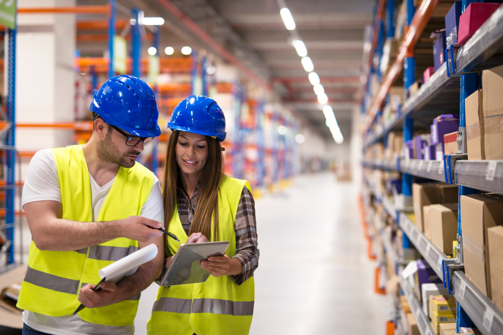 warehouse-workers-checking-inventory-consulting-each-other-about-organization-distribution-goods
