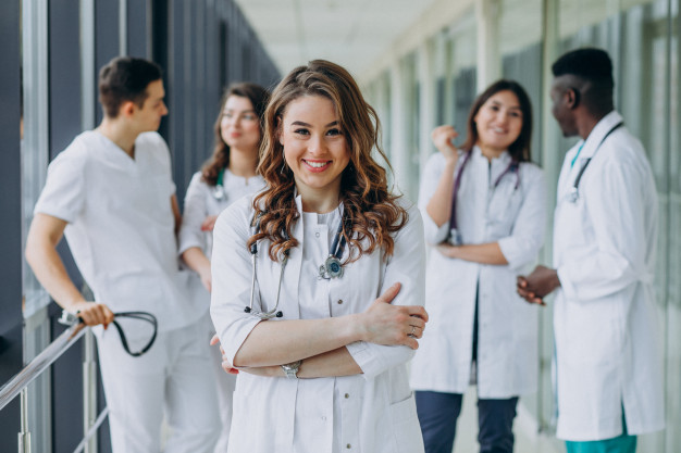 young-female-doctor-posing-corridor-hospital_1303-21212
