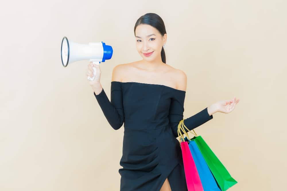 portrait-beautiful-young-asian-woman-smile-with-megaphone-yellow